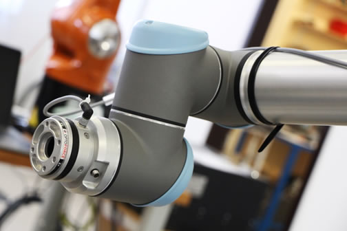 Example of a 6-Axis Force/Torque Sensor attached to a Universal Robot arm